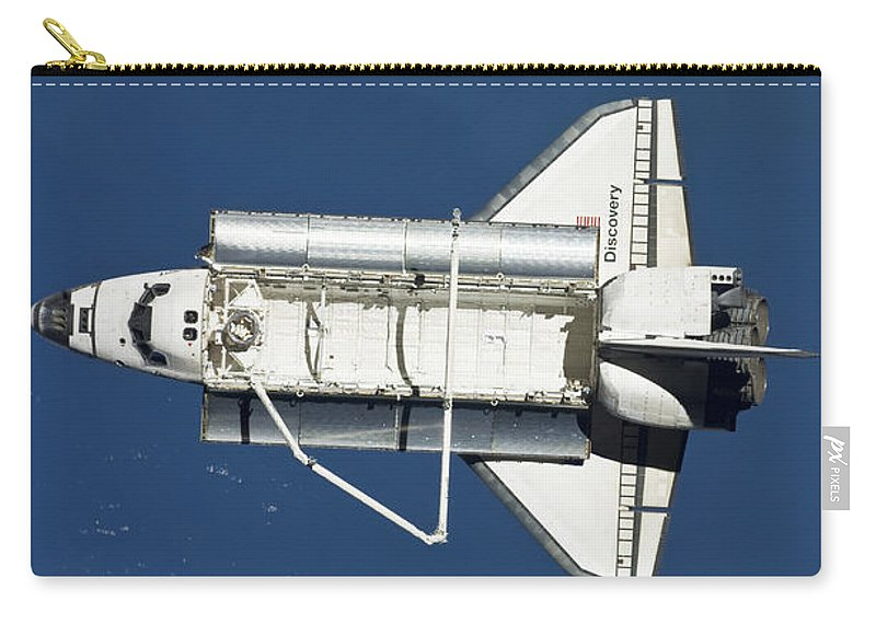 View From Space Carry-all Pouch featuring the photograph Space Shuttle Discovery by Stocktrek Images