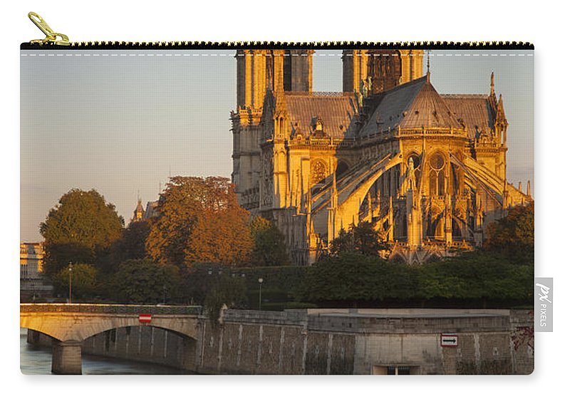 Architectural Carry-all Pouch featuring the photograph Sunrise Over Notre Dame by Brian Jannsen