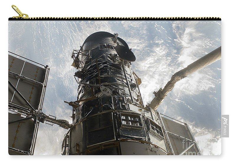 Remote Manipulator System Carry-all Pouch featuring the photograph The Hubble Space Telescope by Stocktrek Images