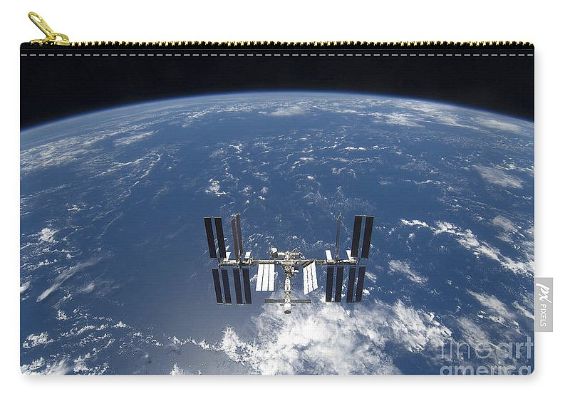 Horizontal Carry-all Pouch featuring the photograph The International Space Station by Stocktrek Images