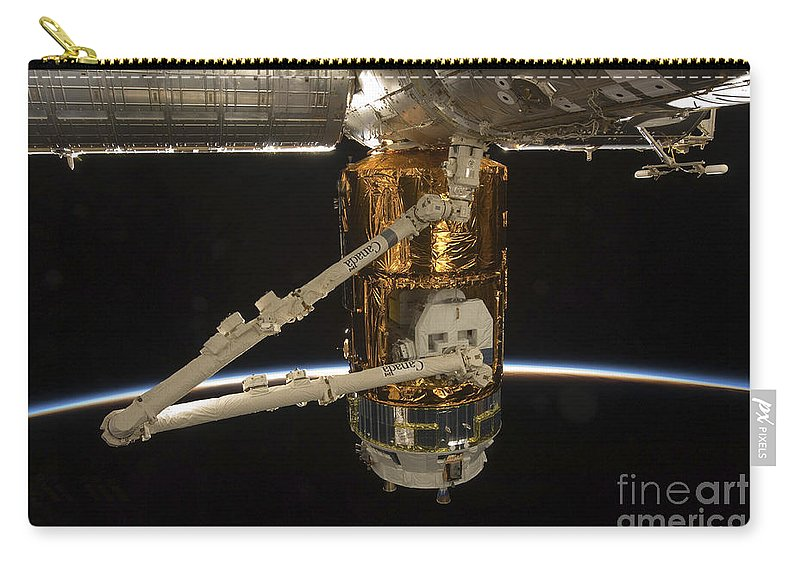View From Space Carry-all Pouch featuring the photograph The Japanese H-ii Transfer Vehicle by Stocktrek Images