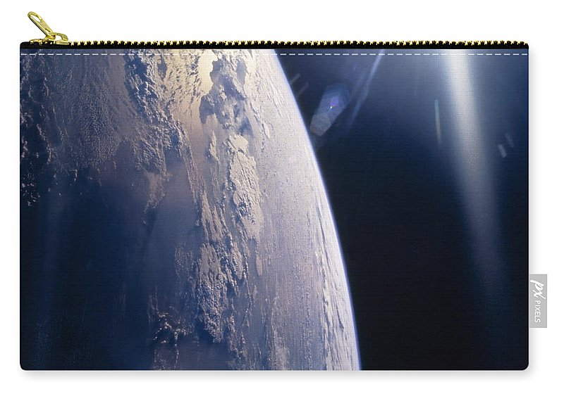 Color Image Carry-all Pouch featuring the photograph The Sun Shining On Planet Earth by Stocktrek Images