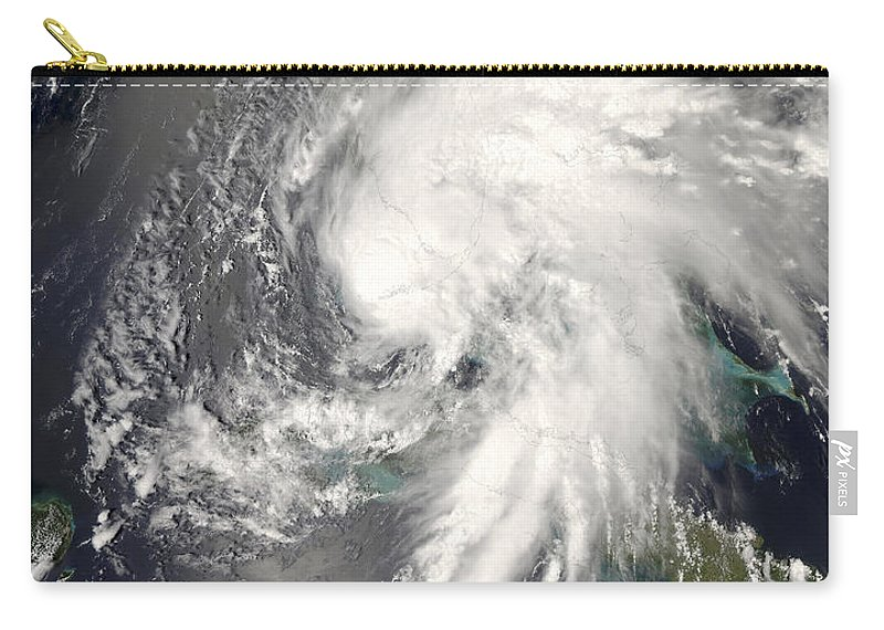 Circulating Carry-all Pouch featuring the photograph Tropical Storm Fay by Stocktrek Images