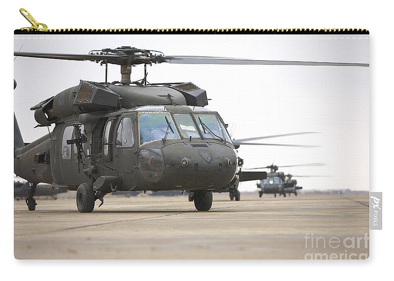 Aviation Carry-all Pouch featuring the photograph Uh-60 Black Hawks Taxis by Terry Moore