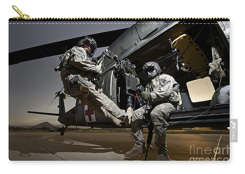 Us Army Carry-all Pouch featuring the photograph U.s. Air Force Crew Strapped by Terry Moore
