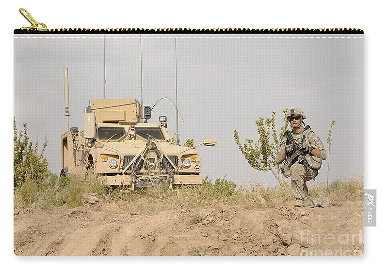 Afghanistan Carry-all Pouch featuring the photograph U.s. Army Sergeant Provides Security by Stocktrek Images