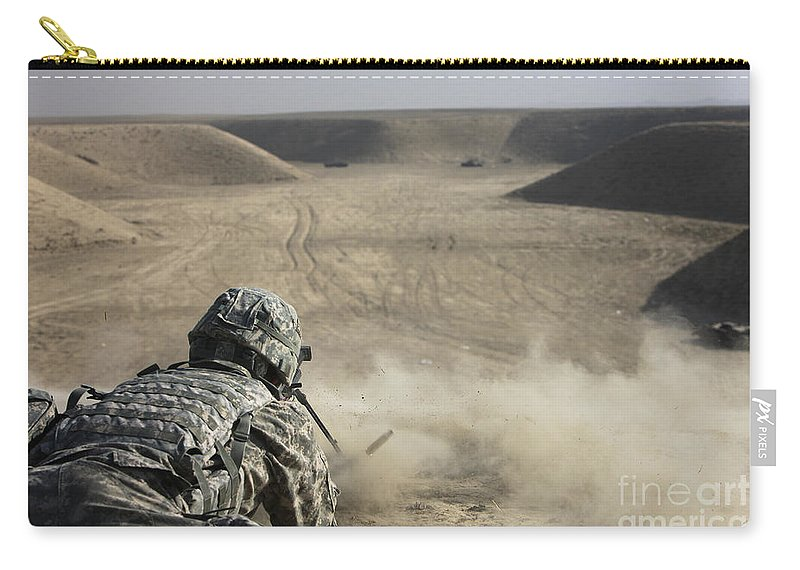 Operation Enduring Freedom Carry-all Pouch featuring the photograph U.s. Army Soldier Fires A Barrett M82a1 by Terry Moore