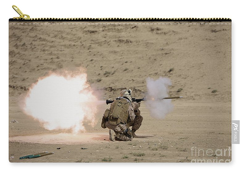 Afghanistan Carry-all Pouch featuring the photograph U.s. Marine Fires A Rpg-7 Grenade by Terry Moore
