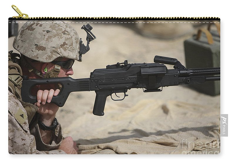 Machine Guns Carry-all Pouch featuring the photograph U.s. Marine Prepares To Fire A Pk by Terry Moore