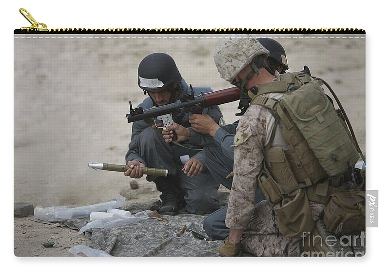 Gun Barrel Carry-all Pouch featuring the photograph U.s. Marine Watches An Afghan Police by Terry Moore