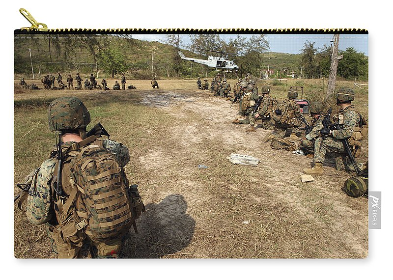 Marine Expeditionary Unit Carry-all Pouch featuring the photograph U.s. Marines Provide Security by Stocktrek Images