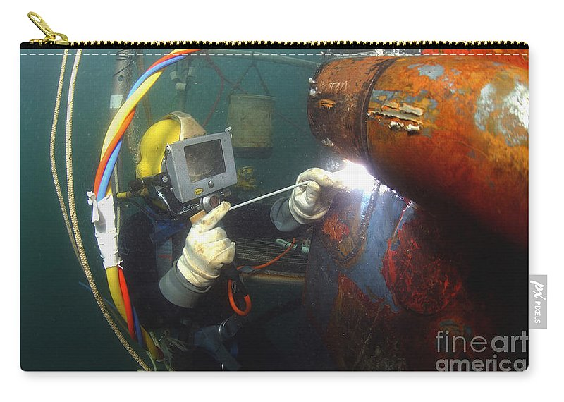 Adults Only Carry-all Pouch featuring the photograph U.s. Navy Diver Welds A Repair Patch by Stocktrek Images
