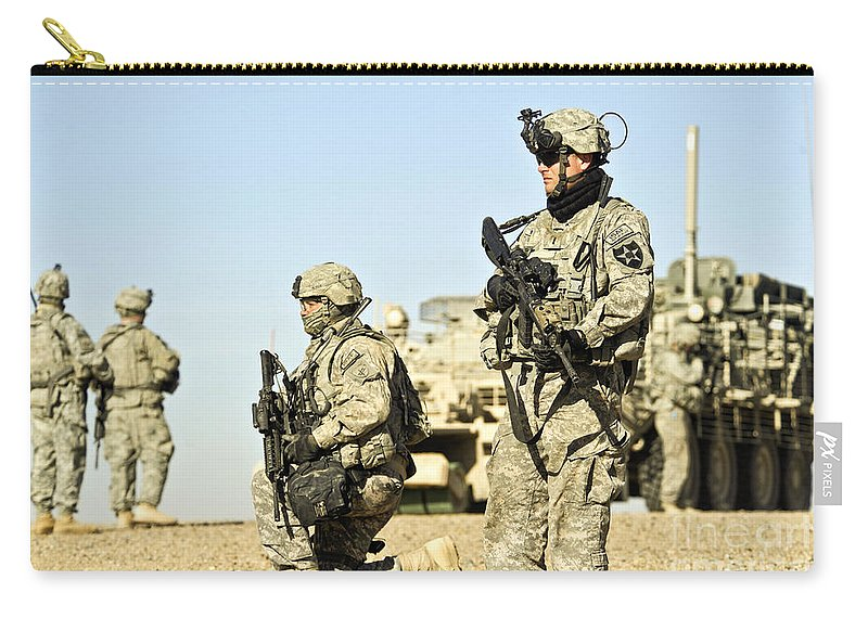 Copy Space Carry-all Pouch featuring the photograph U.s. Soldiers Conduct A Combat Patrol by Stocktrek Images