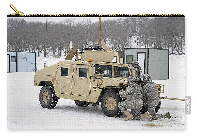 Fort Mccoy Carry-all Pouch featuring the photograph U.s. Soldiers Take Cover by Stocktrek Images