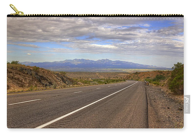 Road Carry-all Pouch featuring the photograph West Into California by Ricky Barnard