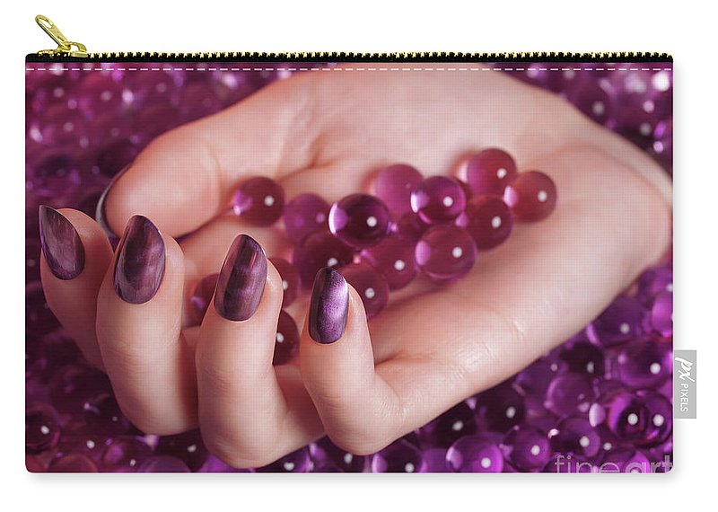 Nail Polish Carry-all Pouch featuring the photograph Woman Hand With Purple Nail Polish On Candy by Oleksiy Maksymenko