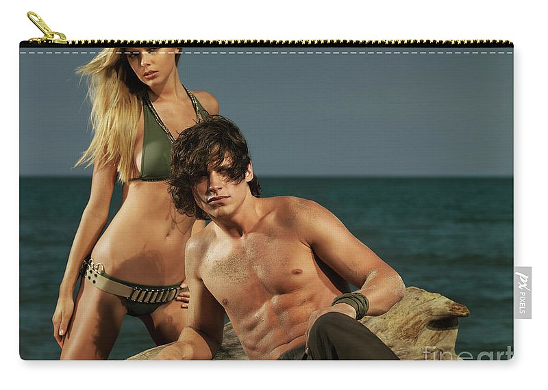 Couple Carry-all Pouch featuring the photograph Young Beautiful Couple At The Beach by Oleksiy Maksymenko