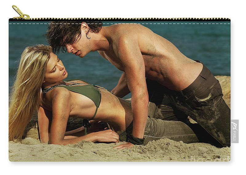 Love Carry-all Pouch featuring the photograph Young Couple On The Beach by Oleksiy Maksymenko