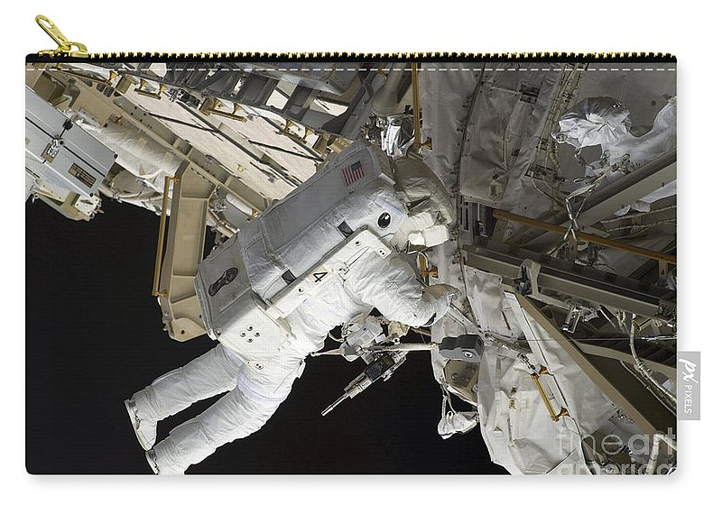 Construction Carry-all Pouch featuring the photograph Astronaut Participates by Stocktrek Images