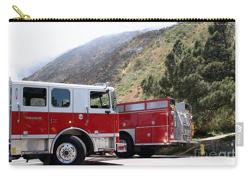 Ash Carry-all Pouch featuring the photograph Barnett Fire by Henrik Lehnerer