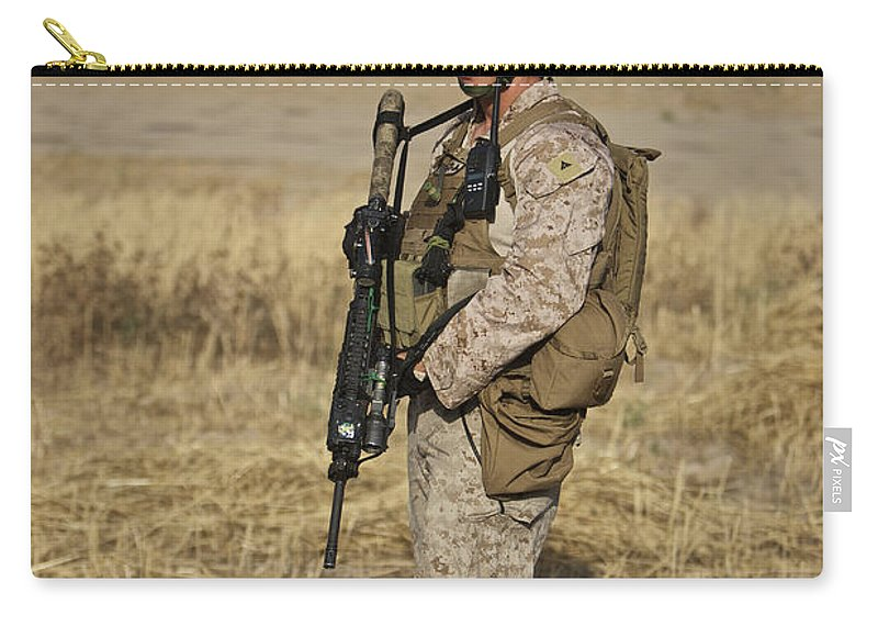Field Carry-all Pouch featuring the photograph U.s. Marine Patrols A Wadi Near Kunduz by Terry Moore