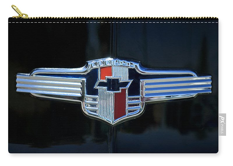1942 Chevrolet Carry-all Pouch featuring the photograph 1942 Chevrolet Emblem by Jill Reger