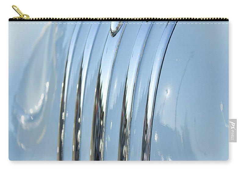 1948 Pontiac Carry-all Pouch featuring the photograph 1948 Pontiac Hood Ornament 3 by Jill Reger