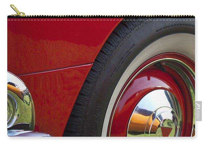 1954 Hudson Hornet Carry-all Pouch featuring the photograph 1954 Hudson Hornet Wheel And Emblem by Jill Reger