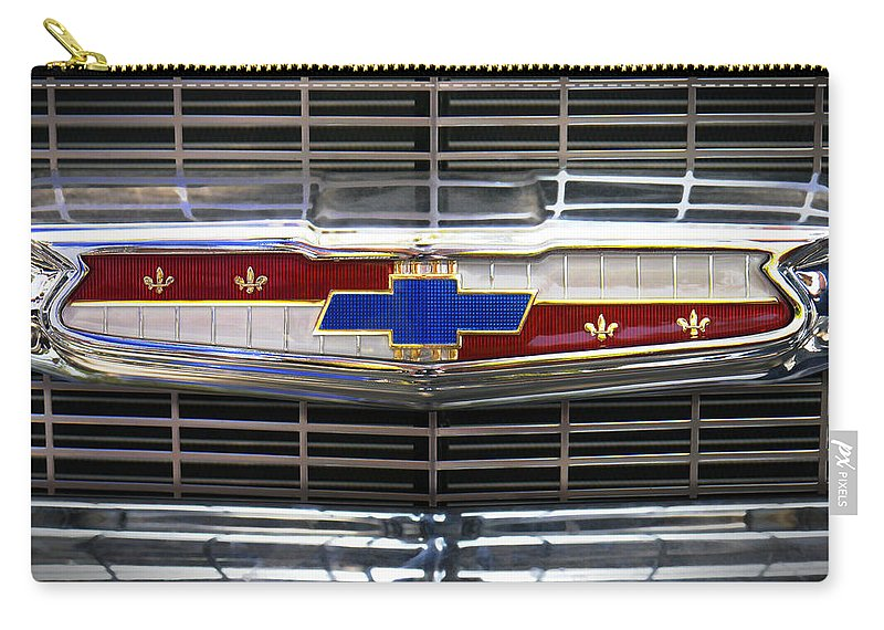 Transportation Carry-all Pouch featuring the photograph 1956 Chevrolet Grill Emblem by Mike McGlothlen