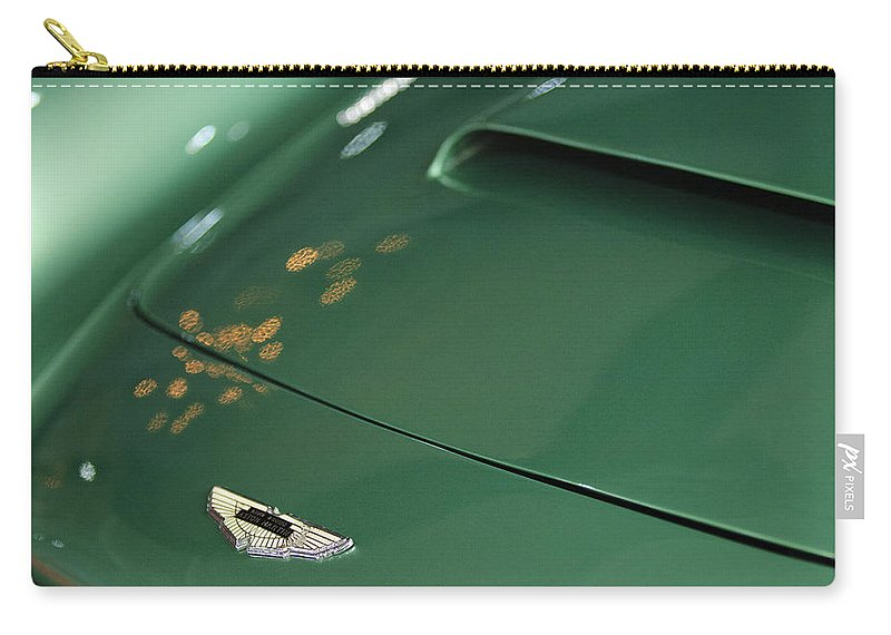 1961 Aston Martin Db4 Series Iv Hood Emblem Carry-all Pouch featuring the photograph 1961 Aston Martin Db4 Series Iv Hood Emblem by Jill Reger