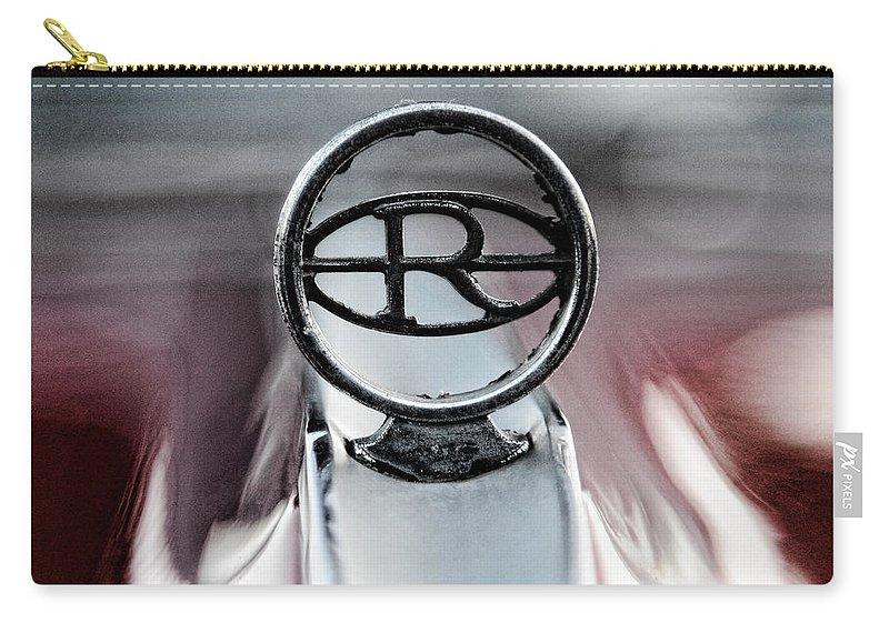 1965 Buick Riveria Hood Emblem Carry-all Pouch featuring the photograph 1965 Buick Riveria Hood Emblem by Paul Ward