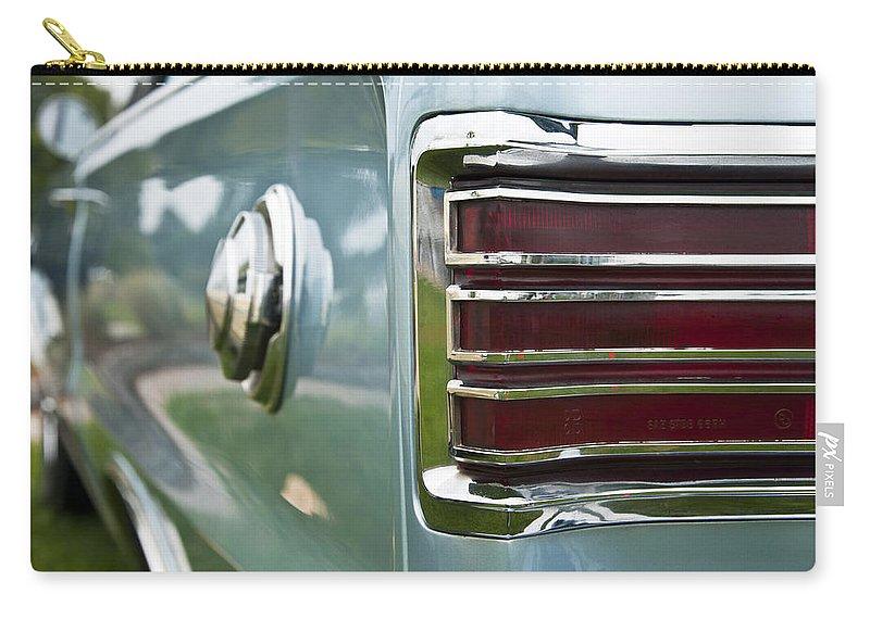 1966 Plymouth Satellite Tail Light Carry-all Pouch featuring the photograph 1966 Plymouth Satellite Tail Light by Glenn Gordon