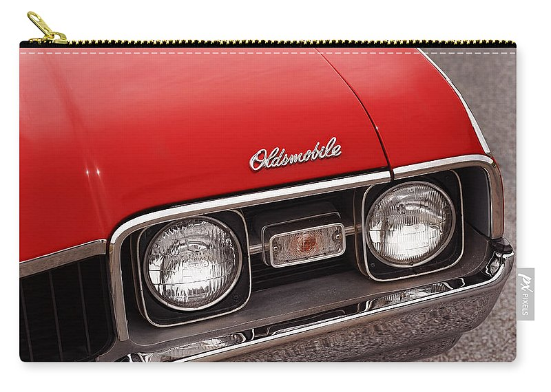 1967 Carry-all Pouch featuring the photograph 1968 Oldsmobile Cutlass Supreme by Gordon Dean II