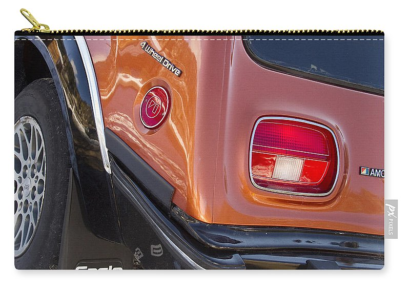 1983 Carry-all Pouch featuring the photograph 1983 Amc Eagle 4 Wheel Drive by James BO Insogna