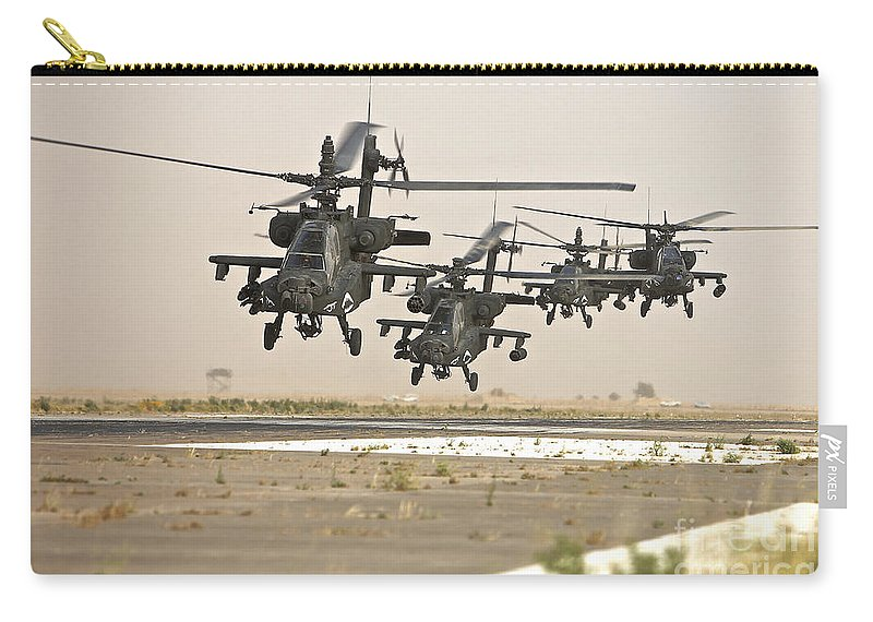 Ah-64 Carry-all Pouch featuring the photograph A Group Of Ah-64d Apache Helicopters by Terry Moore