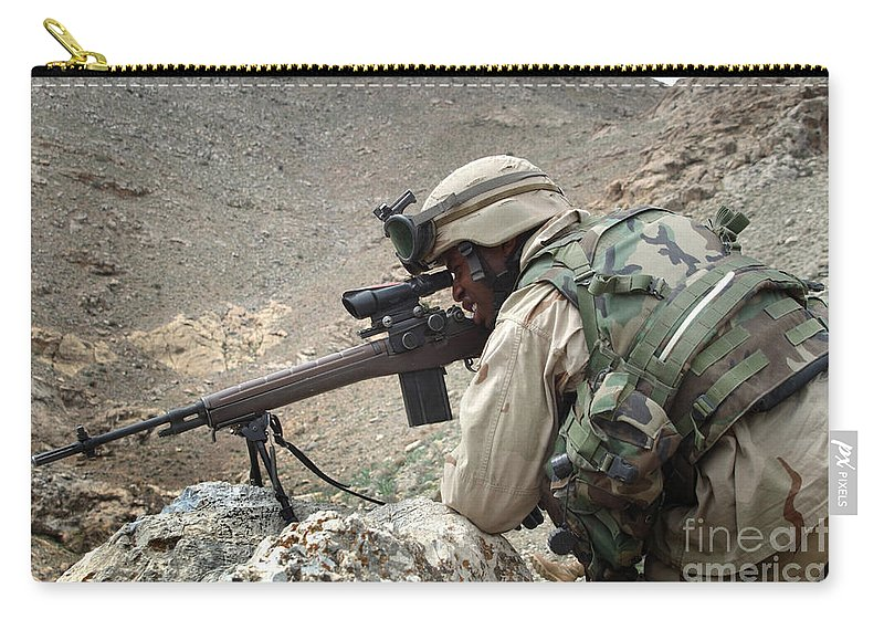 Horizontal Carry-all Pouch featuring the photograph A Soldier Provides Security by Stocktrek Images