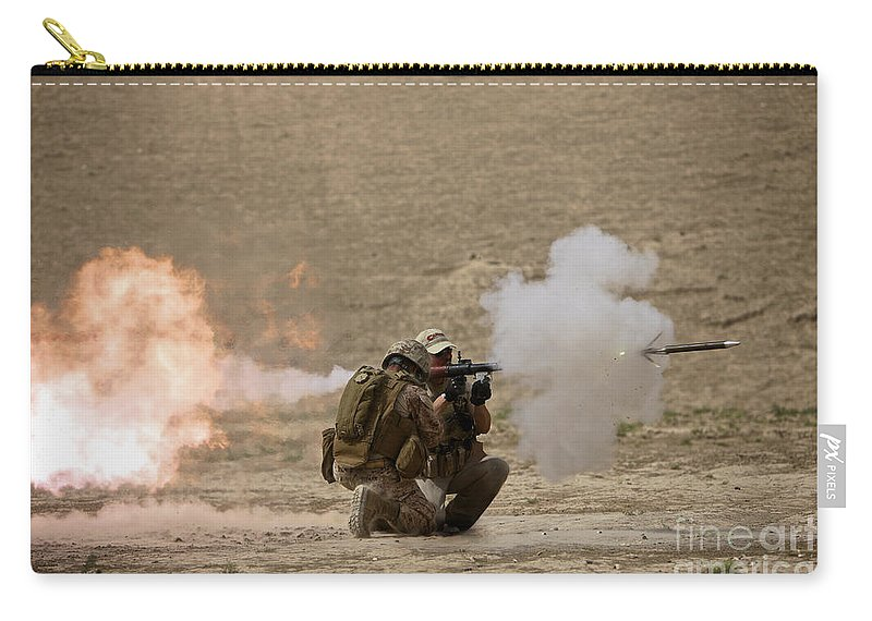 Operation Enduring Freedom Carry-all Pouch featuring the photograph A U.s. Contractor Fires by Terry Moore