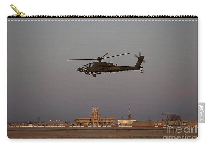 Aircraft Carry-all Pouch featuring the photograph An Ah-64d Apache Longbow Block IIi by Terry Moore