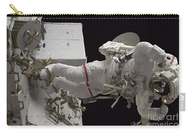 Sts-128 Carry-all Pouch featuring the photograph Astronaut Working On The International by Stocktrek Images
