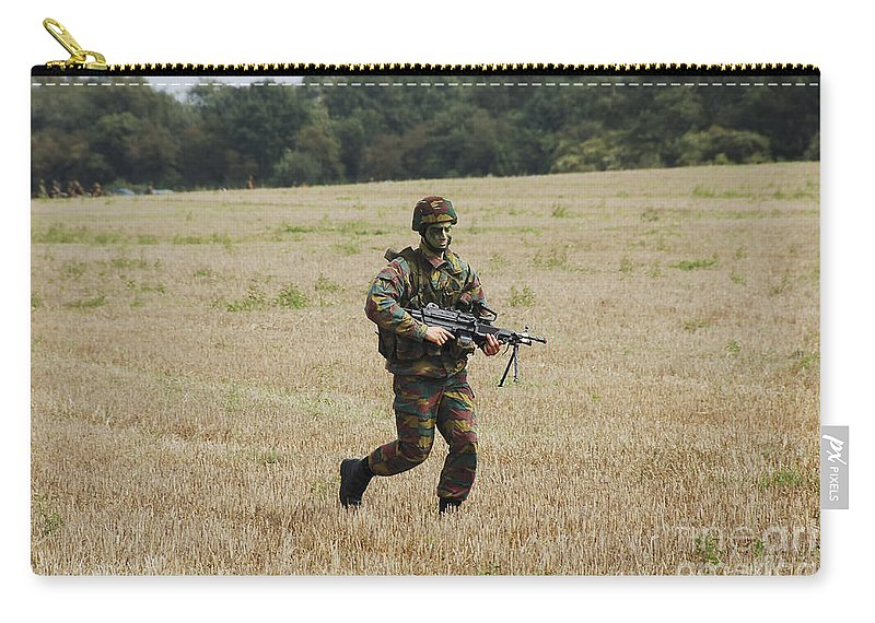 Armed Forces Carry-all Pouch featuring the photograph Belgian Paratroopers Proceeding by Luc De Jaeger