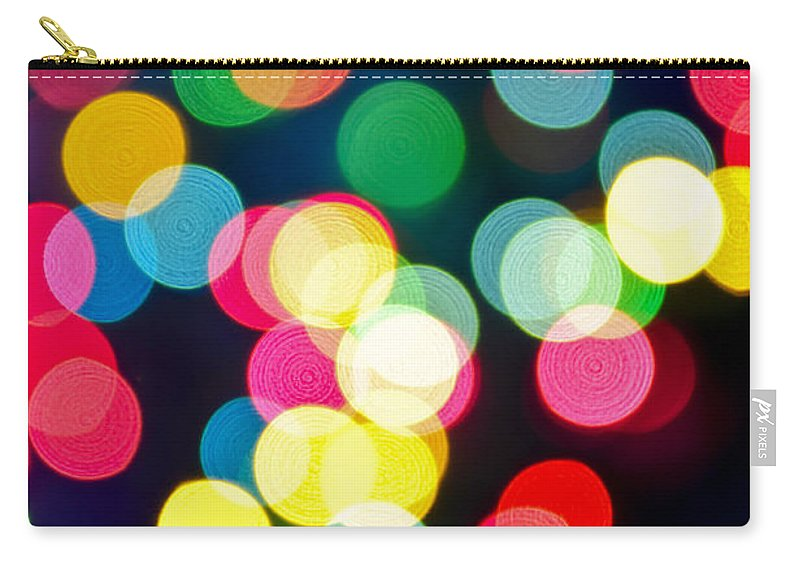 Blurred Carry-all Pouch featuring the photograph Blurred Christmas Lights by Elena Elisseeva