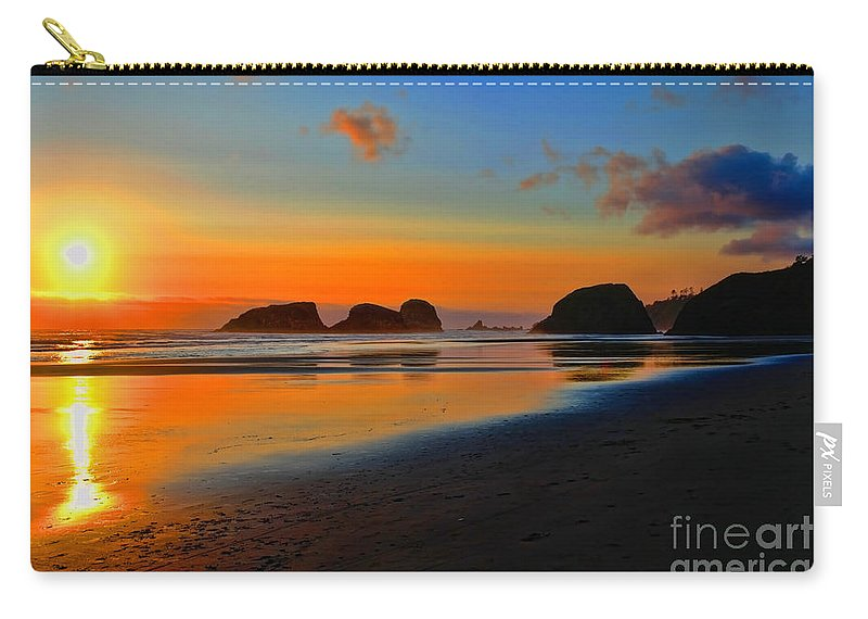 City Of Cannon Beach Located Pacific Northwest Coast Oregon Portland South Of Astoria Carry-all Pouch featuring the photograph Cannon Beach Sunset by RJ Aguilar