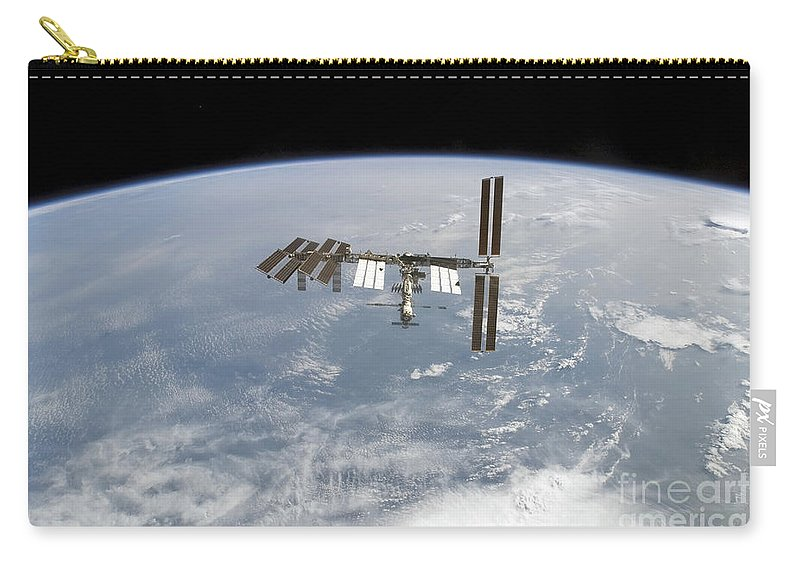 Blue Carry-all Pouch featuring the photograph International Space Station by Stocktrek Images