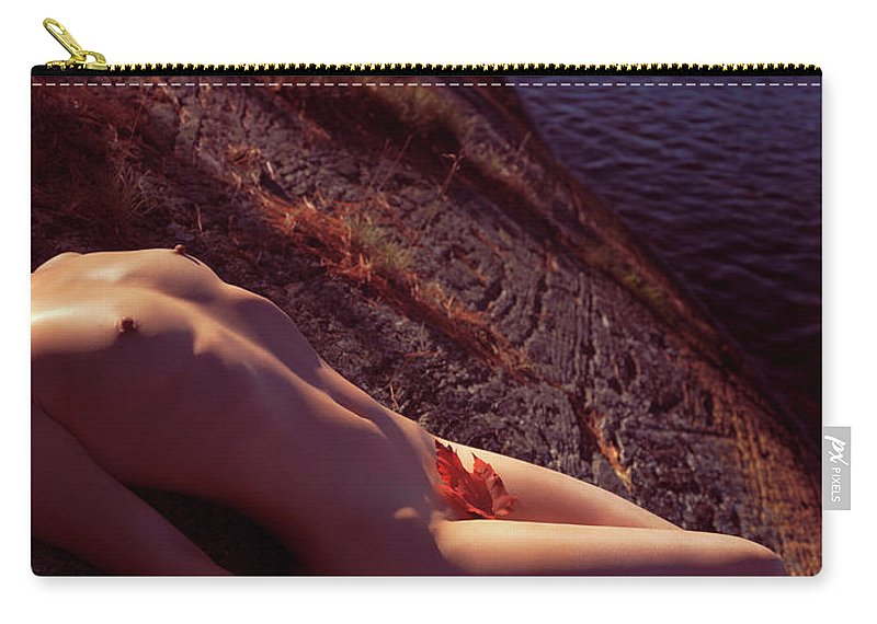 Nude Carry-all Pouch featuring the photograph Nude Woman Lying On Rocks By The Water by Oleksiy Maksymenko