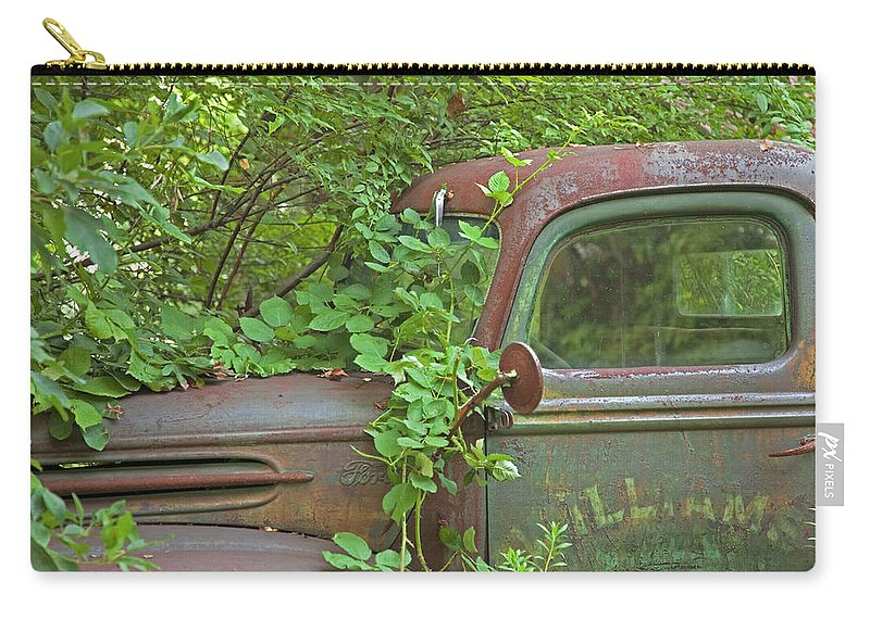 Rustbuckets Carry-all Pouch featuring the photograph Overgrown Rusty Ford Pickup Truck by John Stephens