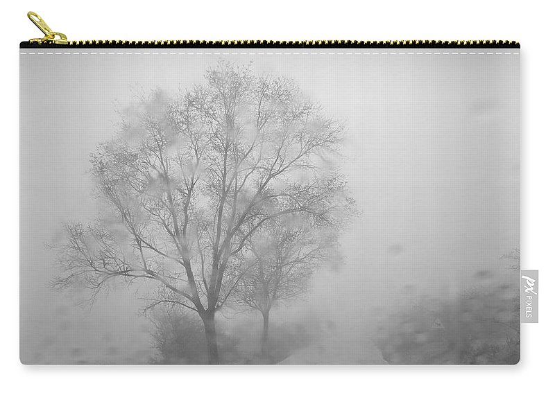 Black And White Carry-all Pouch featuring the photograph Rainy Days by Guido Montanes Castillo
