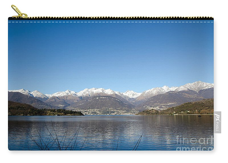 Mountains Carry-all Pouch featuring the photograph Snow-capped Mountain by Mats Silvan