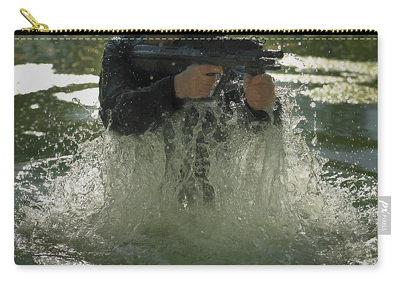 Special Operations Forces Carry-all Pouch featuring the photograph Special Operations Forces Soldier by Tom Weber