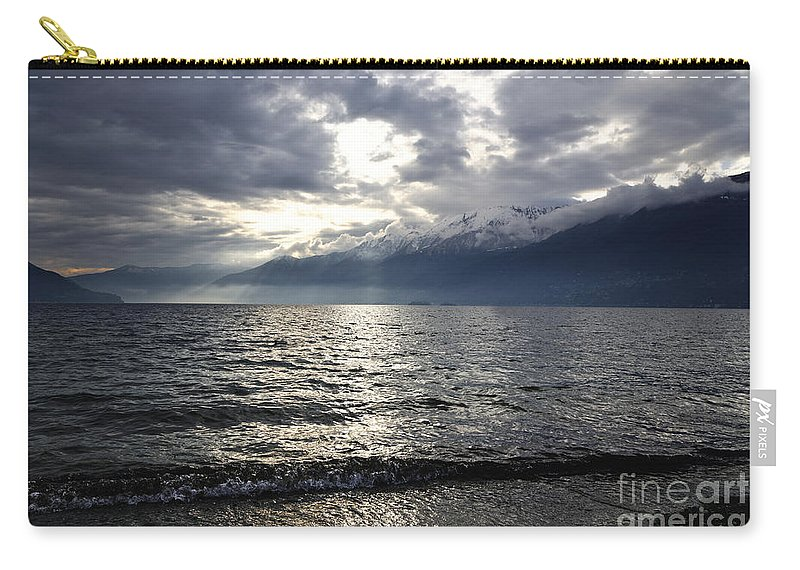 Sunlight Carry-all Pouch featuring the photograph Sunlight Over A Lake by Mats Silvan