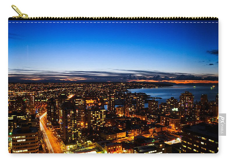 Architecture Carry-all Pouch featuring the photograph Sunset Over A City Nice Illuminated by U Schade